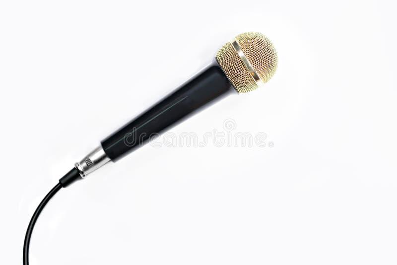 Mikrofonguld på vit royaltyfria foton