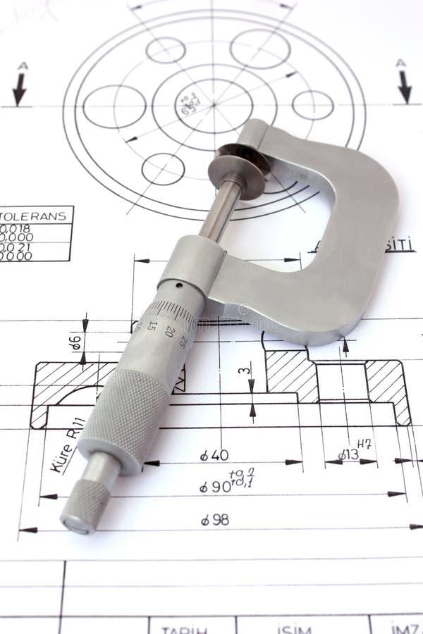 Mikrometer auf technischer Zeichnung. Vertikal lizenzfreies stockfoto
