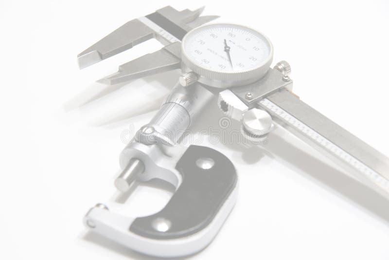 Mikrometer und Schieber-Web-Hintergrund stockbilder