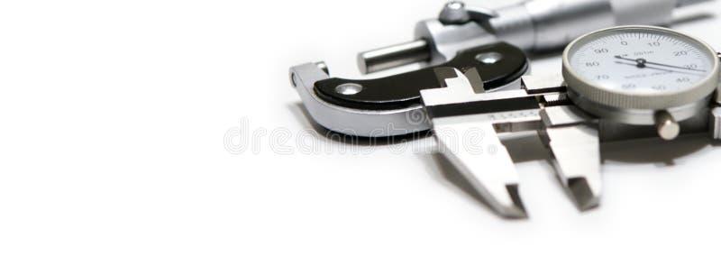 Mikrometer und Schieberweb-Fahne lizenzfreies stockbild