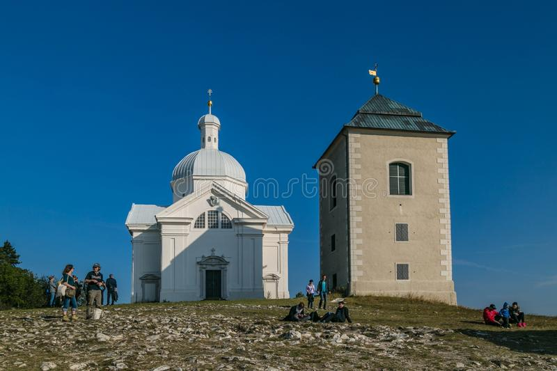 People standing on Holly Hill with Saint Sebastians Chapel. Mikulov, Czech Republic / South Moravia - October 15 2016: People standing on Holly Hill with Saint royalty free stock image