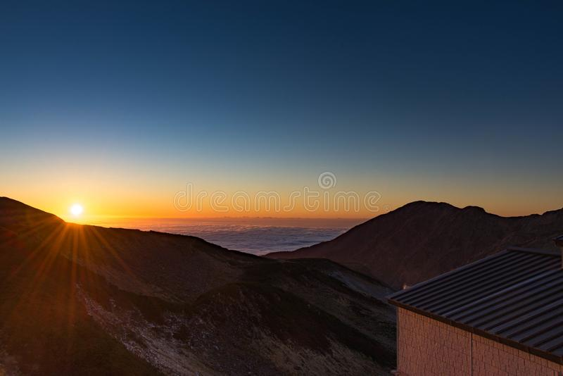 Mikurigaike Hot Spring, the highest altitude natural hot spring in Japan with view of sunset from the hot spring with blue sky, royalty free stock photo