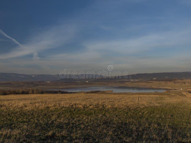Milada lake in winter cold orange evening in north Bohemia stock photography