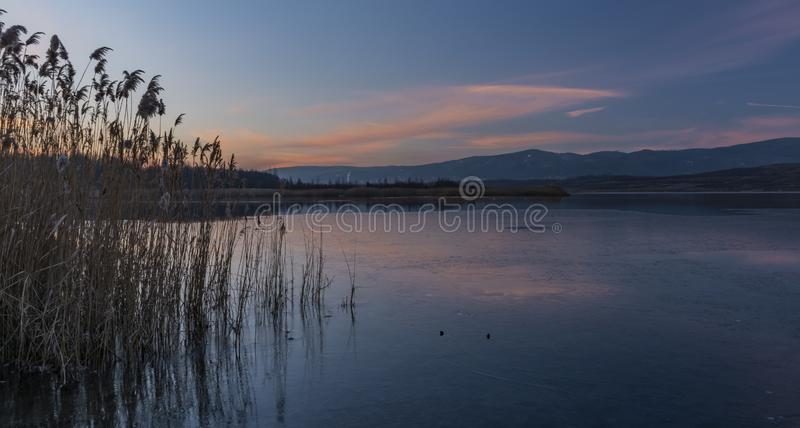Milada lake in winter cold evening in north Bohemia. Milada lake in winter cold color evening in north Bohemia stock photography