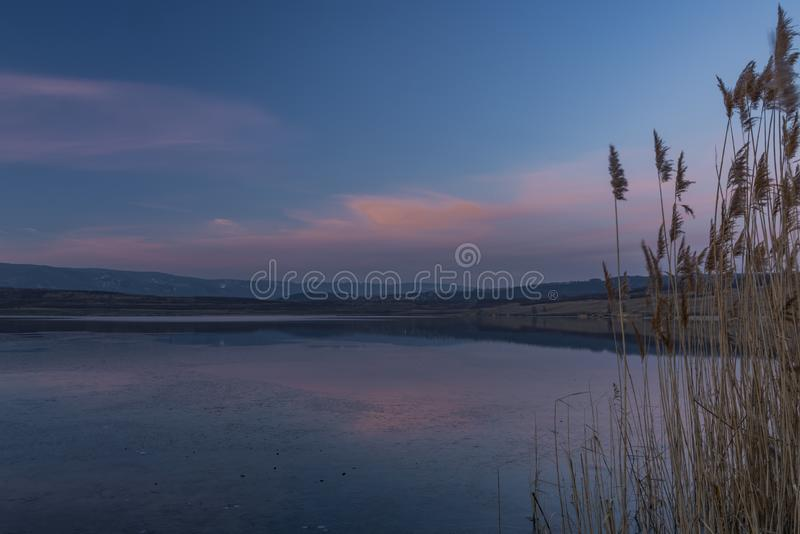 Milada lake in winter cold evening in north Bohemia. Milada lake in winter cold color evening in north Bohemia royalty free stock photos