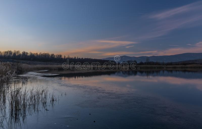 Milada lake in winter cold evening in north Bohemia. Milada lake in winter cold color evening in north Bohemia royalty free stock photography