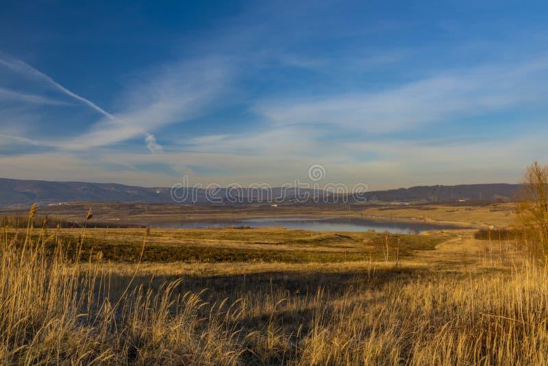 Milada lake in winter cold orange evening in north Bohemia stock images
