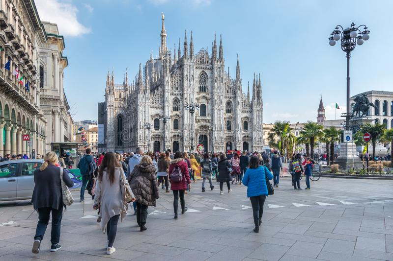 Milan Cathedral from the square with tourists, Italy stock photo
