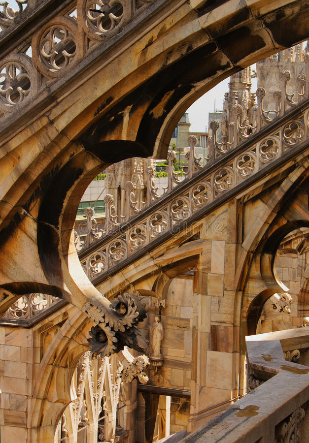 Milan cathedral. Statue and sculptural decoration on the roof of Milan cathedral stock image