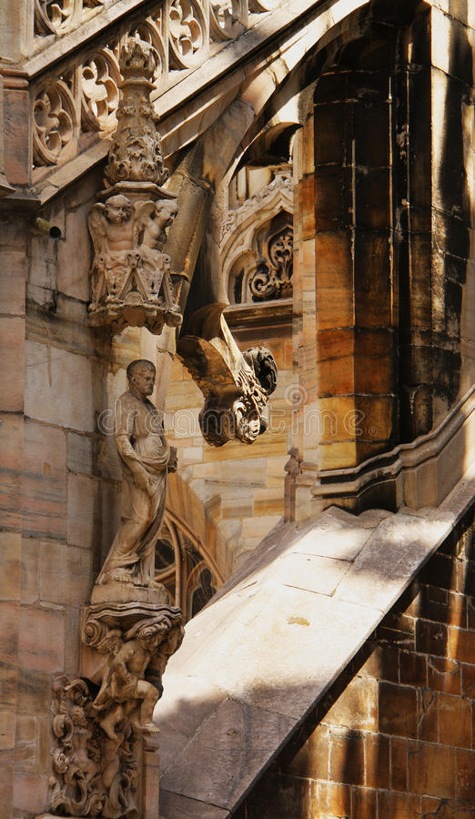 Milan cathedral. Statue and sculptural decoration on the roof of Milan cathedral royalty free stock images