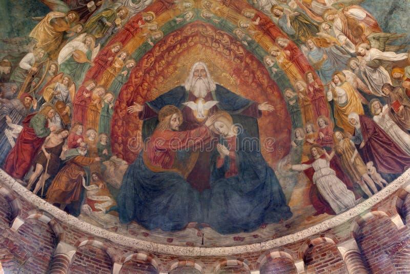 Milan - coronation of mary from Saint Simpliciano. Milan - Holy Trinity and coronation of holy mary - fresco from main apsis of Saint Simpliciano church stock photo
