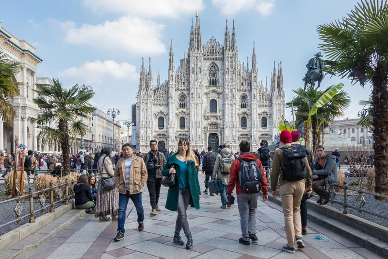Milan Duomo Cathedral view in spring with tourists, Italy stock photos