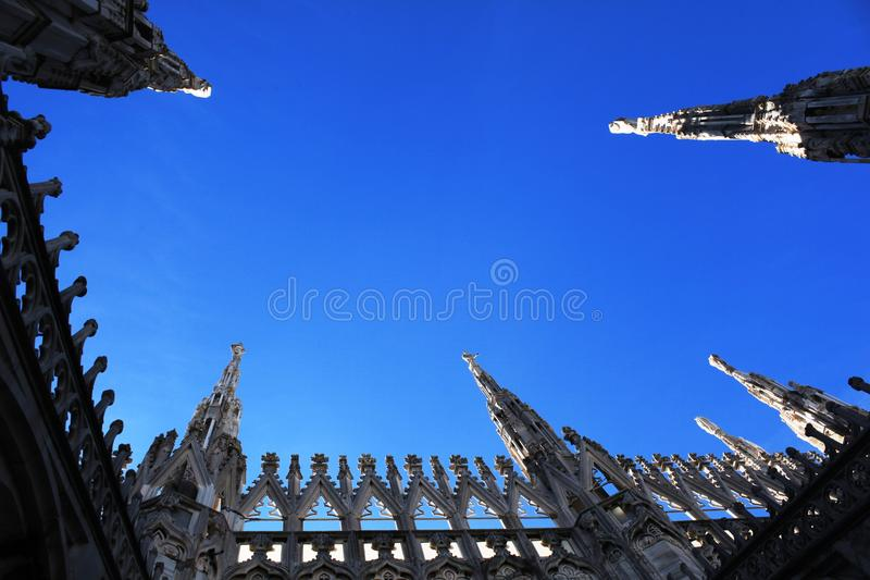 Milan, gothic spires on Duomo cathedral roof royalty free stock photos
