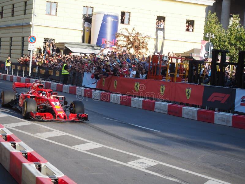 Milan Italien - Augusti 29, 2018: Sebastian Vettel som kör Ferrari royaltyfri fotografi