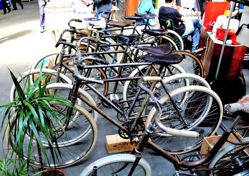 Milan, Italy - April 23, 2017: group of vintage bicycles at a vintage market. Milan, Italy - April 23, 2017: evocative group image of vintage bicycles at a stock photo