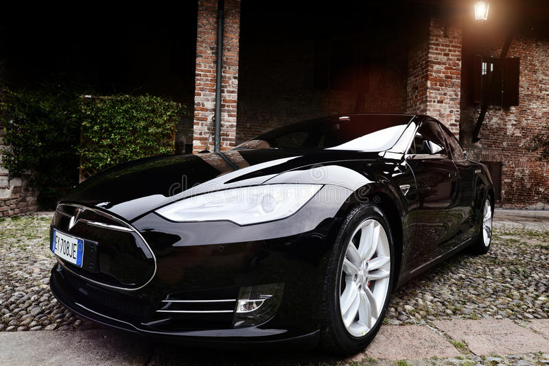 MILAN , ITALY - APRIL 21 2016 : tesla model S car parked in old stock photography