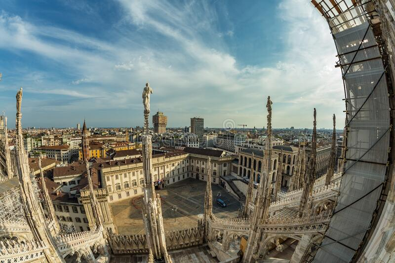 Milan, Italy - Aug 1, 2019: Aerial View from the roof of Milan Cathedral - Duomo di Milano, Lombardy, Italy. Fish eye lens shot.  royalty free stock photo