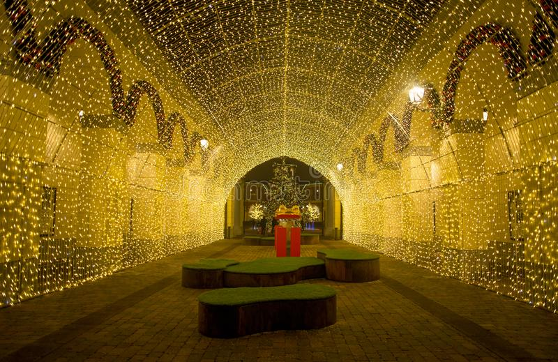 View of a tunnel of lights in `Serravalle Outlet` shopping center on Chistmas time, near Milan, Italy stock photography