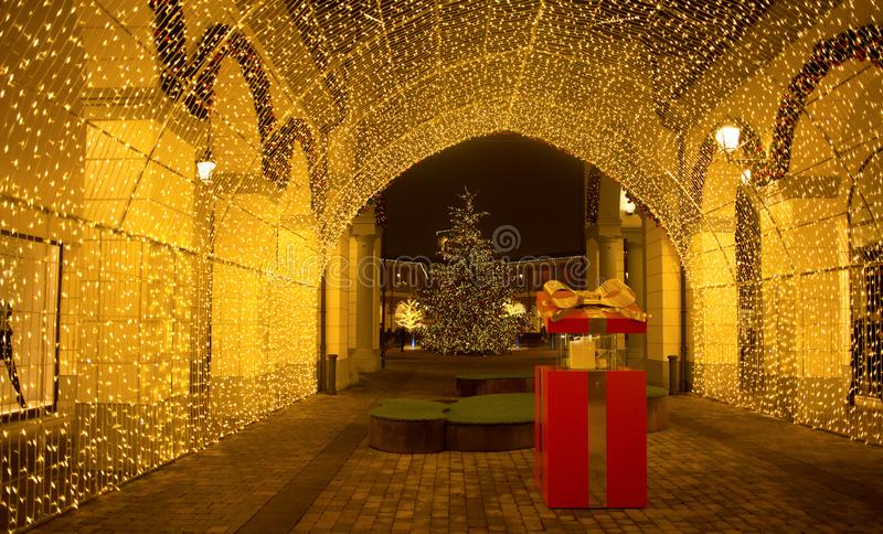 View of a tunnel of lights in `Serravalle Outlet` shopping center on Chistmas time, near Milan, Italy. stock photography