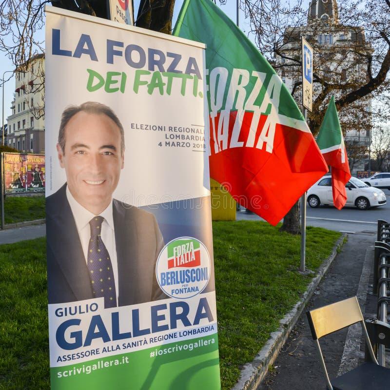 Campaigning on street of Milan, Italy for Giulio Gallera of Berlusconi`s Forza Italia Party ahead of 2018 Italian general electio. Milan, Italy - Feb 13, 2018 stock photos