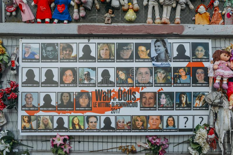 Wall of Dolls protest in Navigli district protesting against female physical and sexual violence, throughout the world. Milan, Italy - Feb 11, 2018: Wall of royalty free stock image