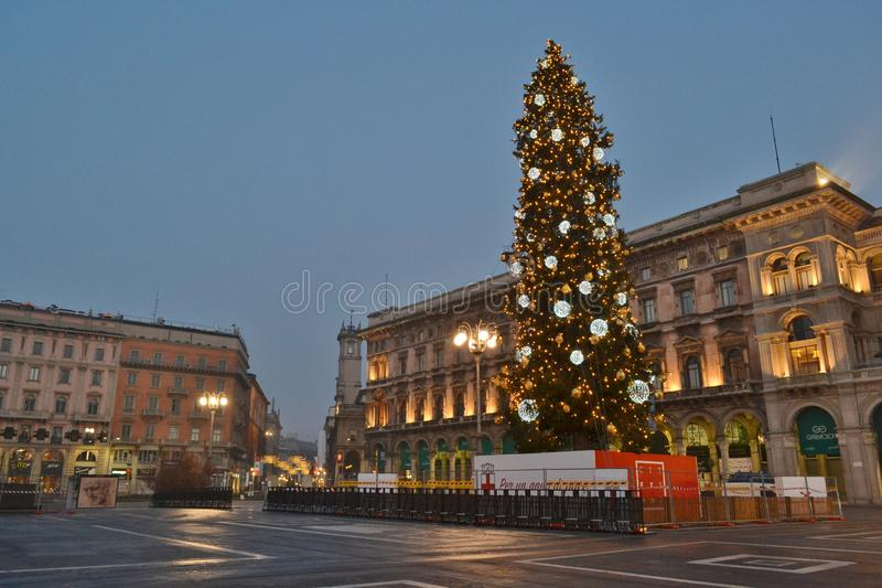 Duomo square decorated with the Christmas Tree in early New Year morning. Milan/Italy - January 1, 2016: Beautiful New Year early morning panoramic view to the stock photography