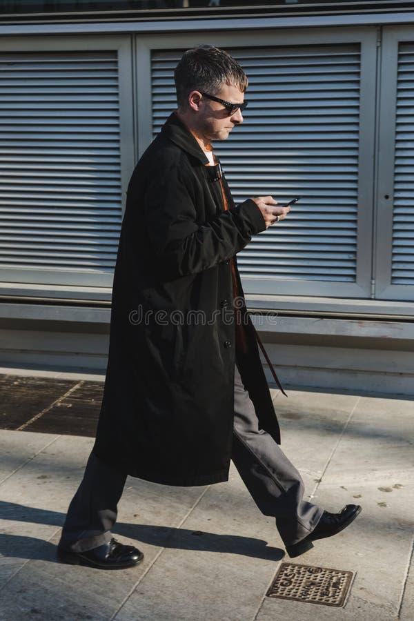 Fashionable man during Milan Men`s Fashion Week stock photography