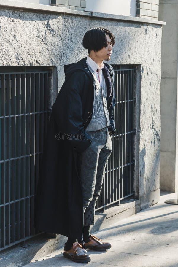 Fashionable man during Milan Men`s Fashion Week royalty free stock photography