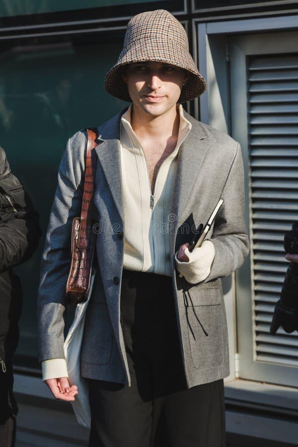 Fashionable man during Milan Men`s Fashion Week royalty free stock image
