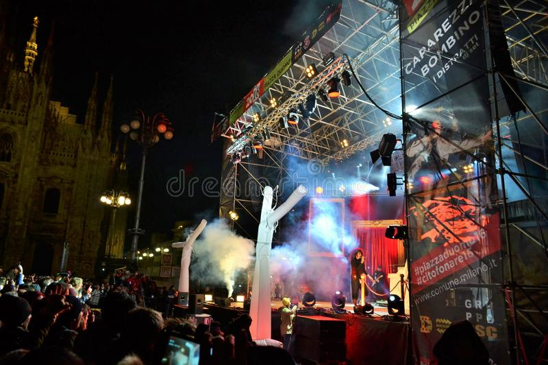 Italian popular rapper Caparezza is singing during the New Year`s concert. Milan, Italy-January 1, 2016:The Italian popular rapper Caparezza is singing during stock images