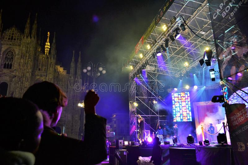 Italian popular rapper Caparezza is singing during the New Year`s concert. Milan, Italy-January 1, 2016:The Italian popular rapper Caparezza is singing during royalty free stock photos