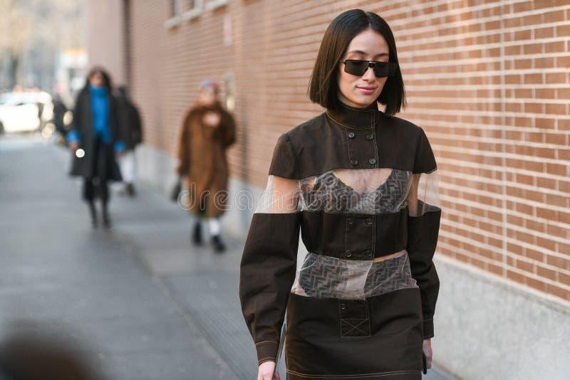 Street style during Milan Fashion Week Men`s royalty free stock photo