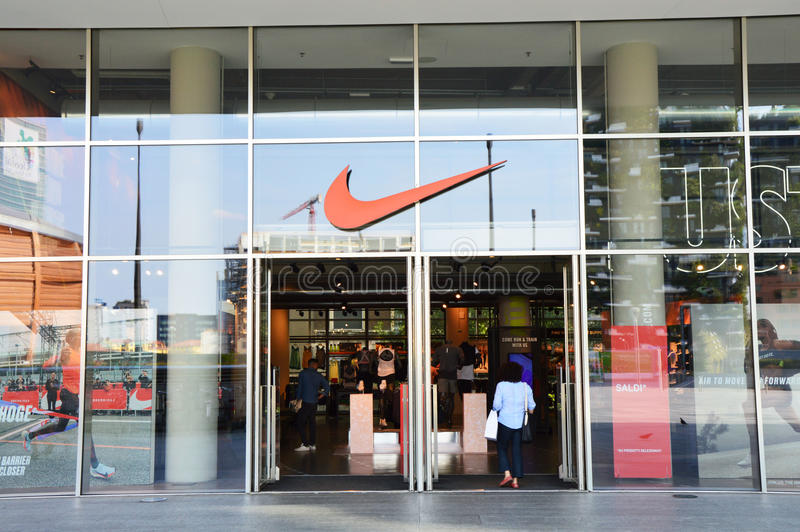 MILAN, ITALY - JULY 19, 2016: Nike store in Gae Aulenti square Milan, Italy. Nike is one of the world`s largest suppliers of athle stock photography
