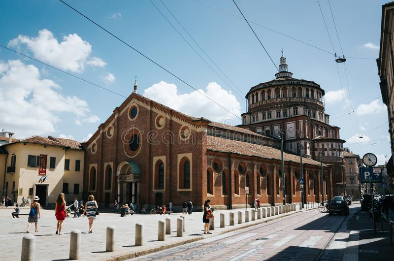 MILAN, ITALY - JULY 17, 2016: People walk in front of Church and Dominican Convent of Santa Maria delle Grazie with The Last stock image