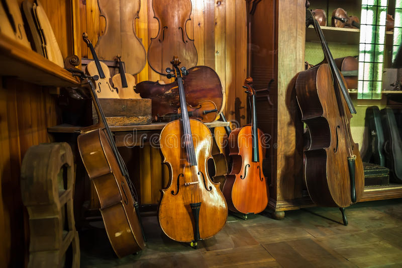 MILAN, ITALY - JUNE 9, 2016: antique violins at the Science and royalty free stock image