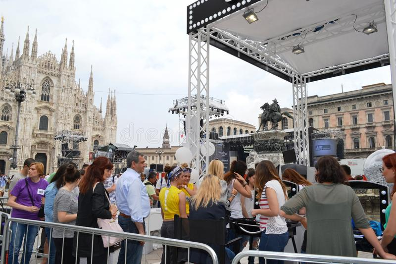 Beauticians receiving customers for free outdoors photo set `Brosway` in Milan Duomo square. stock photography