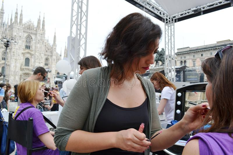 Beauticians receiving customers for free outdoors photo set `Brosway` in Milan Duomo square. stock image