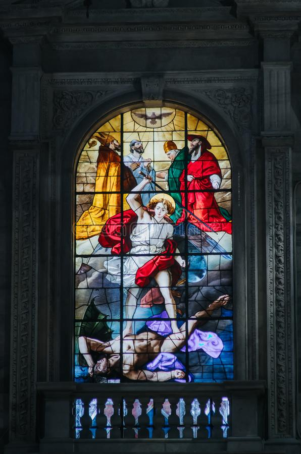 MILAN, ITALY - JUNE 18, 2016: Beautiful interior of the famous cathedral Duomo di Milano (Dome of Milan). Closeup stained glass royalty free stock images