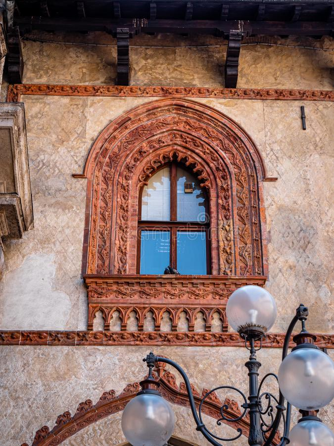 Example of old Italian window architecture found in the old quarter in the center of Milan Italy royalty free stock photography