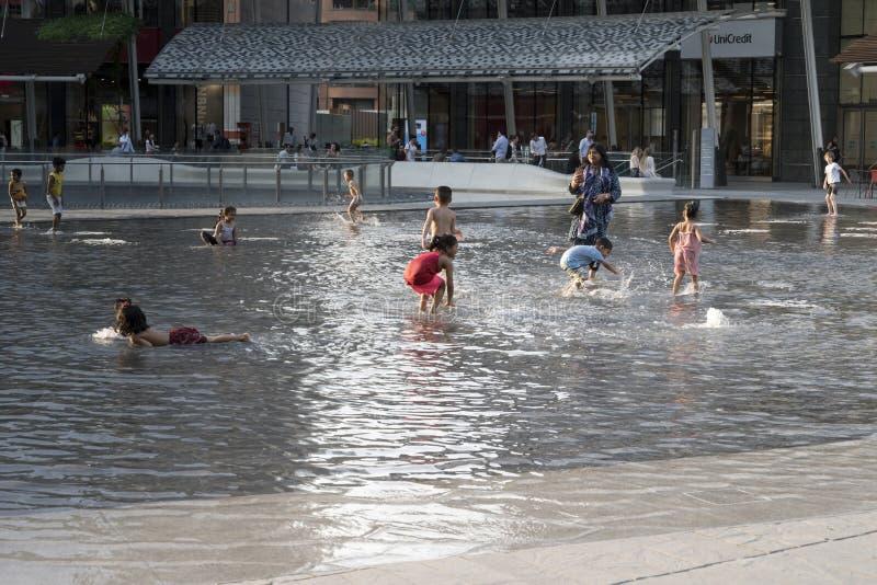 Splashing at business hub, Milan stock photos