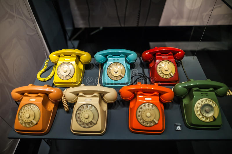 MILAN, ITALY - JUNE 9, 2016: multicoloured old phones at the Sci. Ence and Technology Museum Leonardo da Vinci royalty free stock images