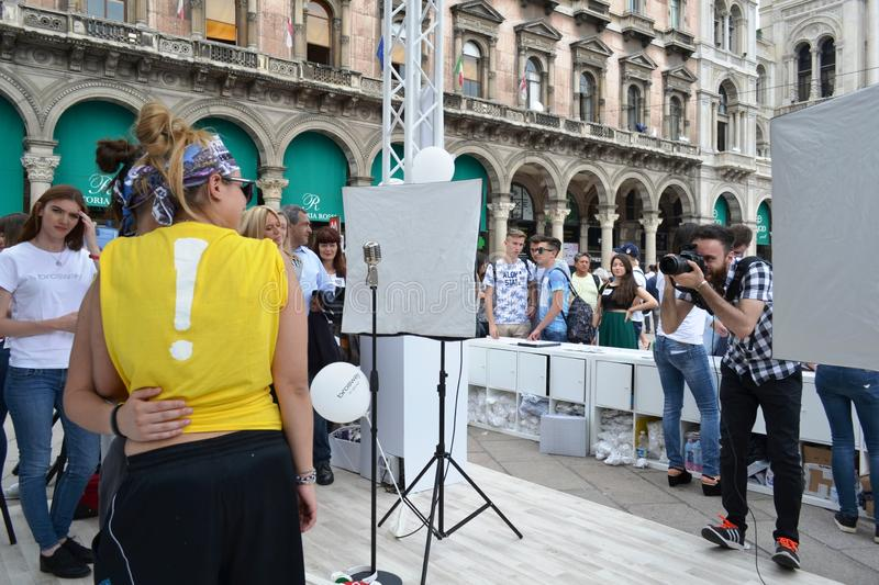 People waiting to be photographed for free on outdoors photo set `Brosway` in Milan Duomo square. Milan, Italy - June 9, 2016:  People on outdoors fun photo set royalty free stock photos