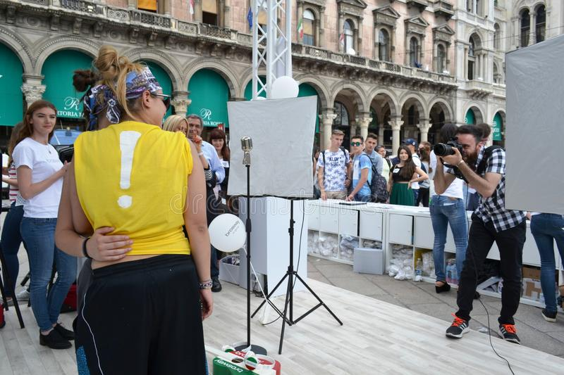 People waiting to be photographed for free on outdoors photo set `Brosway` in Milan Duomo square. Milan, Italy - June 9, 2016:  People on outdoors fun photo set royalty free stock photography