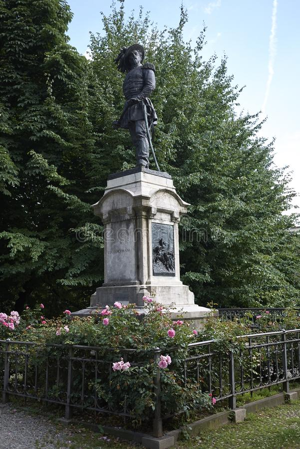 View of Luciano Manara statue. Milan, Italy - June 08, 2018 : View of Luciano Manara statue in Palestro garden stock image