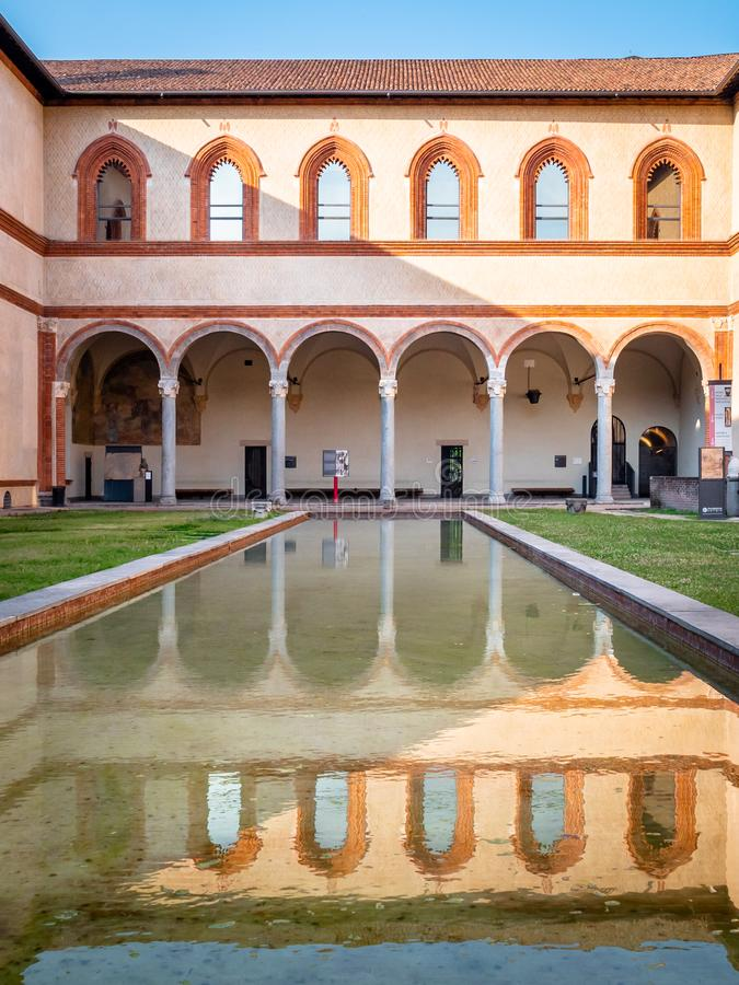 View of 15th Centaury Sforza Castle Fortress inner courtyard living quarters with swimming pool. Milan, Italy - June 30, 2019: View of 15th Centaury Sforza royalty free stock images
