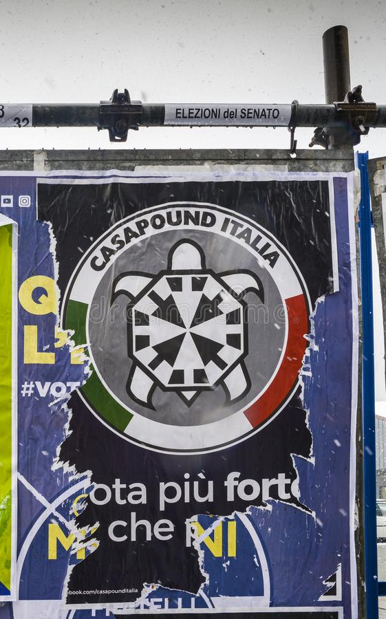 Election posters on billboard ahead of Italian General Election on March 4th, 2018 - CasaPound Italy is a neo-fascist royalty free stock images