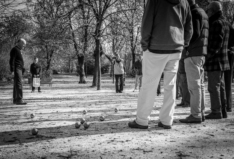 Milan, Italy - March 23, 2016: Aged men play the popular boules stock photography