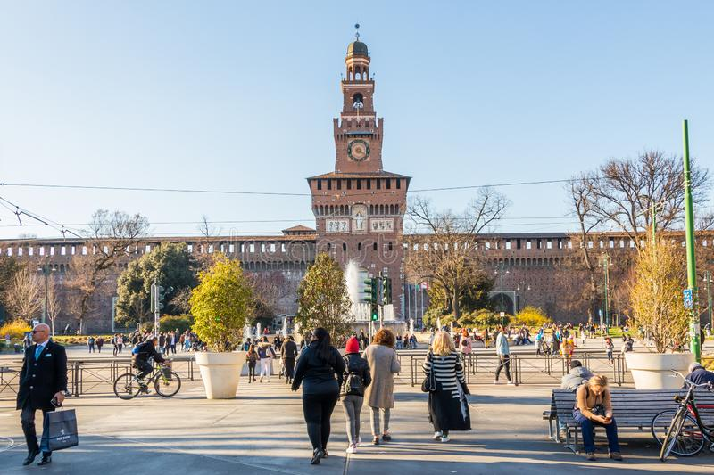 Milan, Italy - March 8, 2019: Crowded downtown Milan in front of the Sforzesco Castle, Italy stock photos