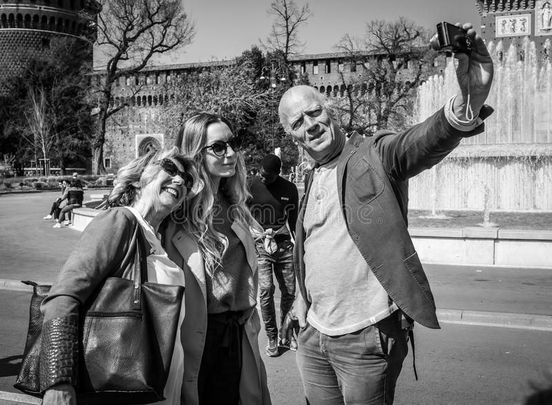 Milan, Italy - March 23, 2016: Group of tourists made a selfie a stock images