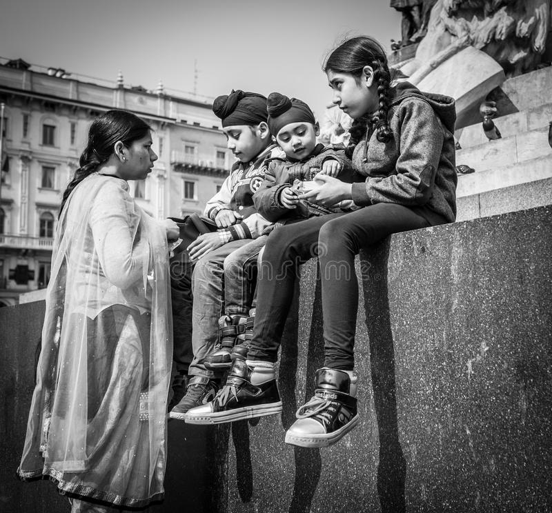 Milan, Italy - March 23, 2016: Sikh family : a mother and tree k stock photo